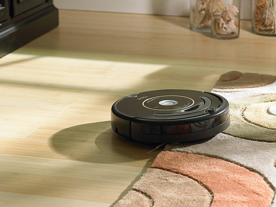 """<p>A vacuum cleaner that cleans my house without my help? Sign us up! The <a href=""""https://www.popsugar.com/buy/iRobot-Roomba-675-Robot-Vacuum-545905?p_name=iRobot%20Roomba%20675%20Robot%20Vacuum&retailer=amazon.com&pid=545905&price=269&evar1=geek%3Aus&evar9=36026397&evar98=https%3A%2F%2Fwww.popsugar.com%2Ftech%2Fphoto-gallery%2F36026397%2Fimage%2F45606311%2FiRobot-Roomba-675-Robot-Vacuum&list1=gifts%2Cgift%20guide%2Cdigital%20life%2Ctech%20gifts%2Cgifts%20for%20men&prop13=mobile&pdata=1"""" class=""""link rapid-noclick-resp"""" rel=""""nofollow noopener"""" target=""""_blank"""" data-ylk=""""slk:iRobot Roomba 675 Robot Vacuum"""">iRobot Roomba 675 Robot Vacuum</a> ($269) will definitely cut down your cleaning time, with a side bonus: it'll be good for your back because you won't have to bend to vacuum those hard-to-reach spots.</p>"""