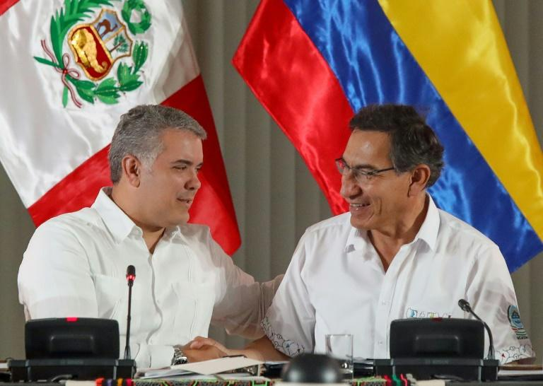 Colombia President Ivan Duque (L) and his Peruvian counterpart Martin Vizcarra proposed an emergency summit to protect the Amazon rainforest