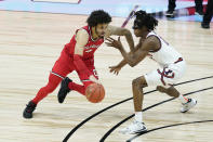 Ohio State's Duane Washington Jr. (4) is defended by Illinois's Ayo Dosunmu (11) during the second half of an NCAA college basketball championship game at the Big Ten Conference tournament, Sunday, March 14, 2021, in Indianapolis. (AP Photo/Darron Cummings)