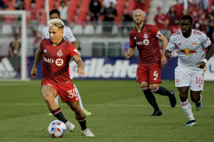 Toronto FC midfielder Yeferson Soteldo (30) moves the ball forward during the first half of an MLS soccer match against the New York Red Bulls on Wednesday, July 21, 2021, in Toronto. (Chris Katsarov/The Canadian Press via AP)