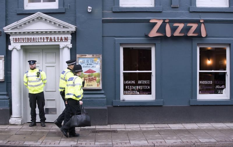 Police stand guard outside the Zizzi restaurant on Tuesday (Picture: PA)