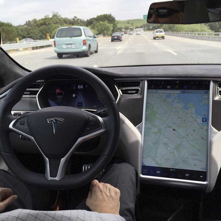 <p>In this March 23, 2018, file photo provided by KTVU, emergency personnel work a the scene where a Tesla electric SUV crashed into a barrier on U.S. Highway 101 in Mountain View, Calif.</p> (AP)