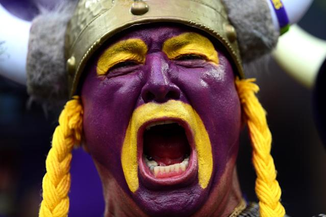 LONDON, ENGLAND - SEPTEMBER 29: A Minnesota fan cheers on his team during the NFL International Series game between Pittsburgh Steelers and Minnesota Vikings at Wembley Stadium on September 29, 2013 in London, England. (Photo by Jamie McDonald/Getty Images)