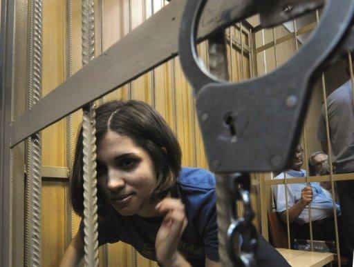 Nadezhda Tolokonnikova, a member of Russian punk band Pussy Riot, sits inside a defendant's cage in a Moscow court on July 4. The trial of three members of the all-girl punk band charged for performing an anti-Vladimir Putin song in the country's main cathedral has gripped Russians, some describing the court drama as better than the theatre