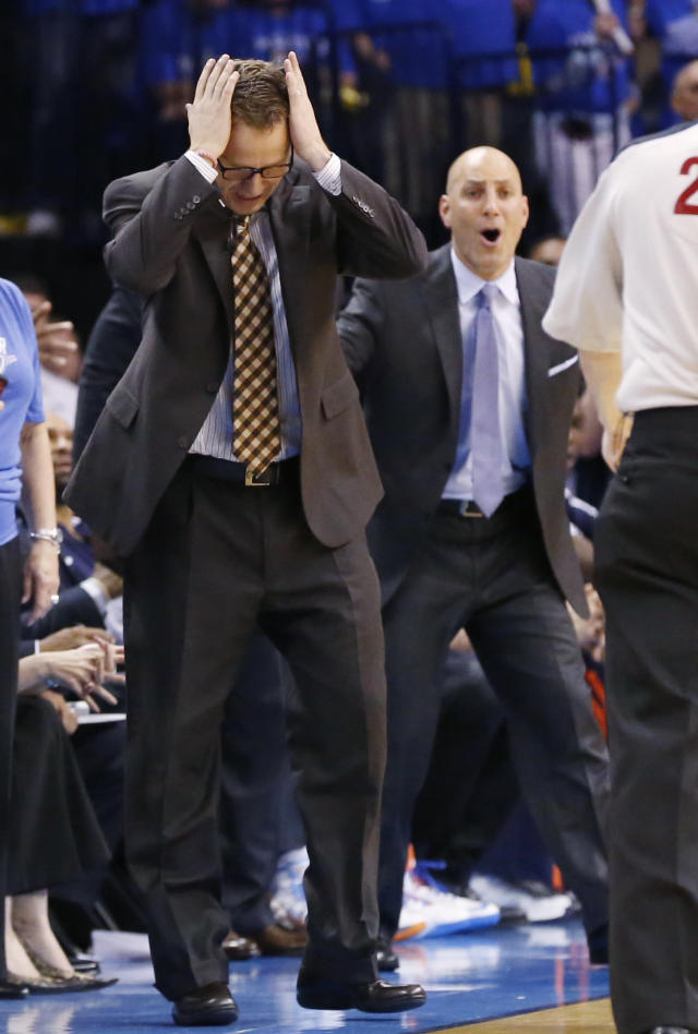 Oklahoma City Thunder head coach Scott Brooks, left, and assistant coach Rex Kalamian, right, react to an official's call in overtime of Game 2 of an opening-round NBA basketball playoff series against the Memphis Grizzlies in Oklahoma City, Monday, April 21, 2014. Memphis won 111-105 in overtime. (AP Photo/Sue Ogrocki)
