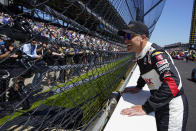 Ed Carpenter talks with fans through the fence before the Indianapolis 500 auto race at Indianapolis Motor Speedway in Indianapolis, Sunday, May 30, 2021. (AP Photo/Michael Conroy)