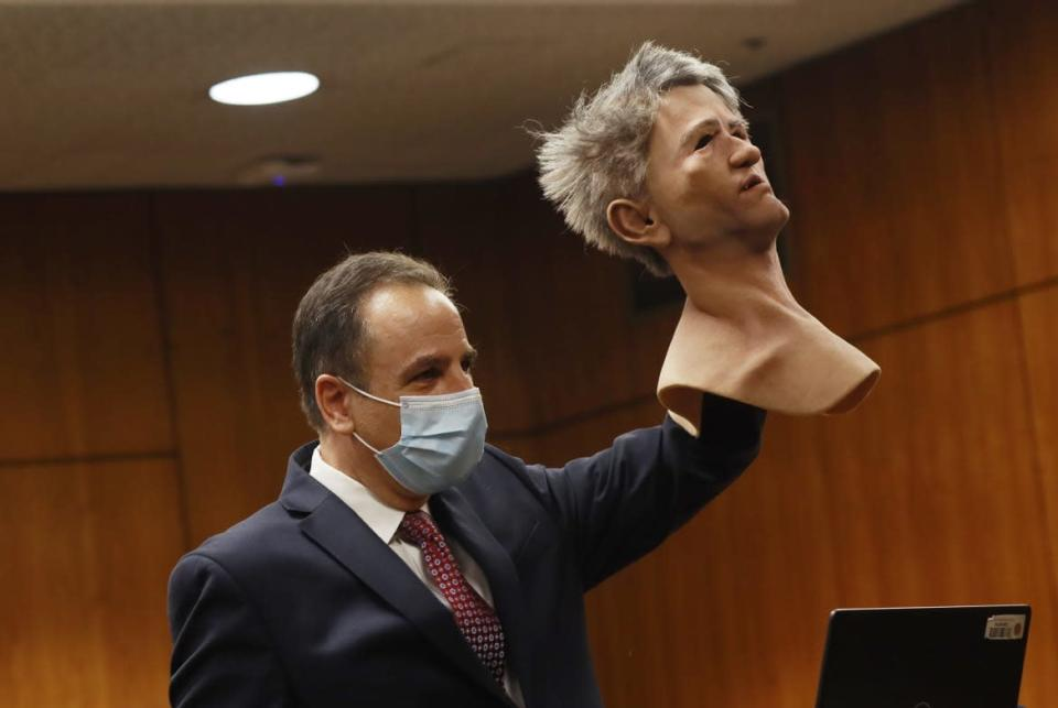 """<div class=""""inline-image__caption""""><p>Deputy District Attorney Habib A. Balian holds a rubber latex mask, donned by Robert Durst when police arrested him along with a fake ID and more than $42,000 in cash.</p></div> <div class=""""inline-image__credit"""">Pool/Getty</div>"""