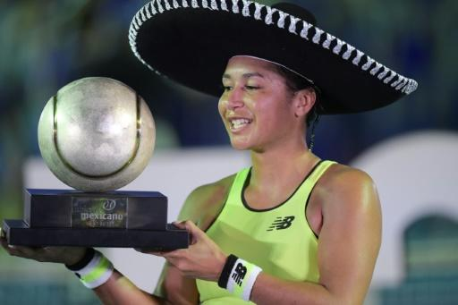 British tennis player Heather Watson celebrates her first WTA Tour title in three years at the Mexico Open