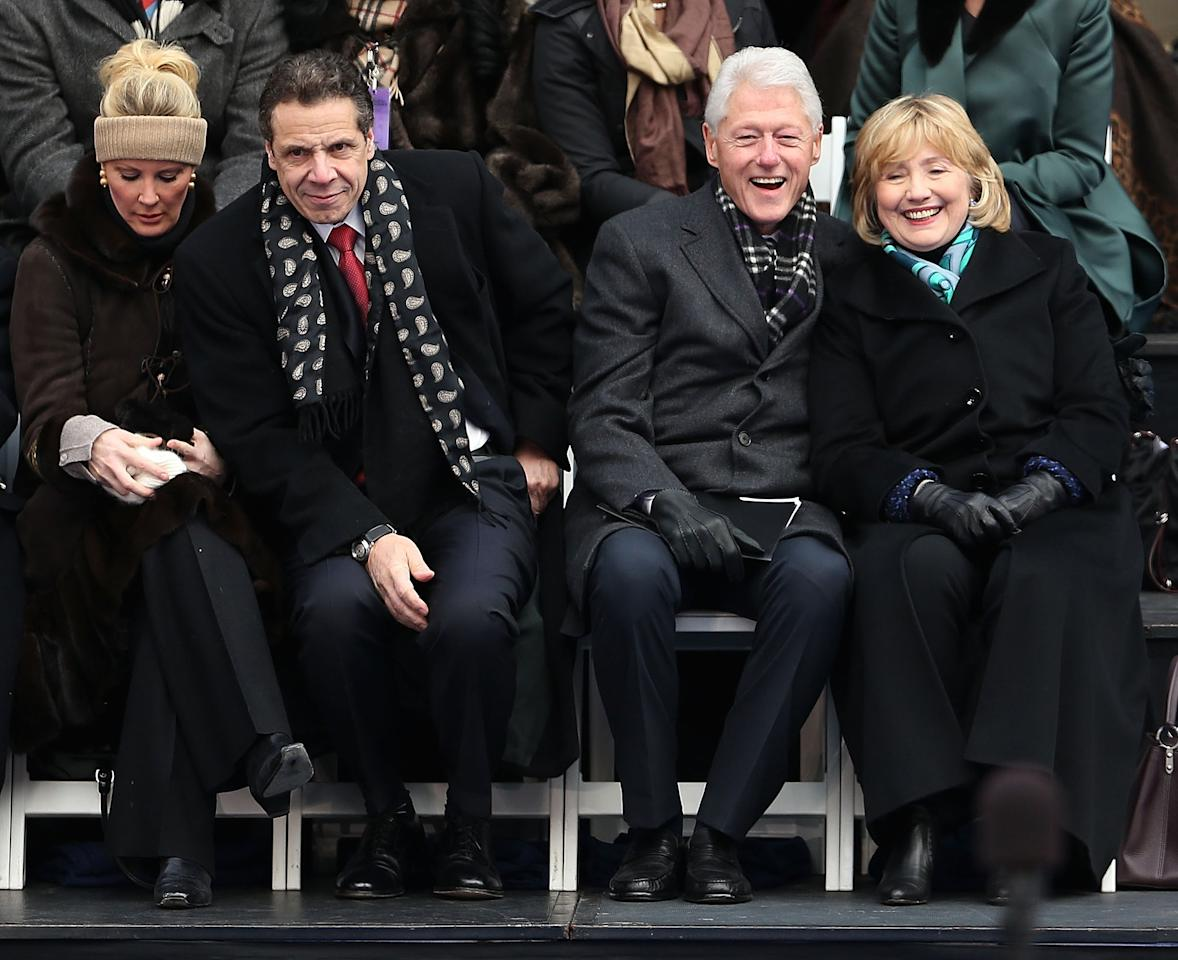 "Lee and Cuomo with Bill and Hillary Clinton as they watched N.Y.C. Mayor Bill de Blasio's swearing-in in January 2014.  Though she had already been with him for several years, Lee's relationship with Cuomo made more headlines as he successfully ran for New York's governor in 2010 (he is now in his third term), even as Lee largely avoided the campaign trail.  ""I do food and home and garden and leave politics to my honey — he's wonderful at that,"" she said in 2010."