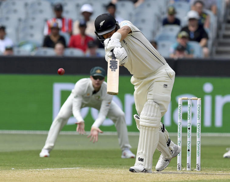 New Zealand's Ross Taylor edges the ball to slips to be dismissed by Australia during their cricket test match in Melbourne, Australia, Saturday, Dec. 28, 2019. (AP Photo/Andy Brownbill)
