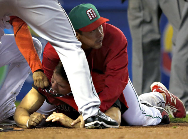 Canada and Mexico players fight during the ninth inning of a World Baseball Classic game, Saturday, March 9, 2013, in Phoenix. (AP Photo/Matt York)