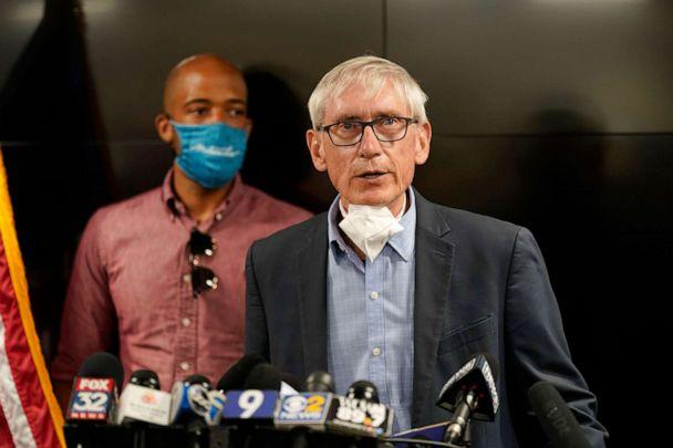 PHOTO: Wisconsin Governor Tony Evers speaks during a news conference, Aug. 27, 2020, in Kenosha, Wis. The city has suffered from unrest in the wake of the police shooting of Jacob Blake. Lt. Gov. Mandela Barnes is at rear. (Morry Gash/AP)