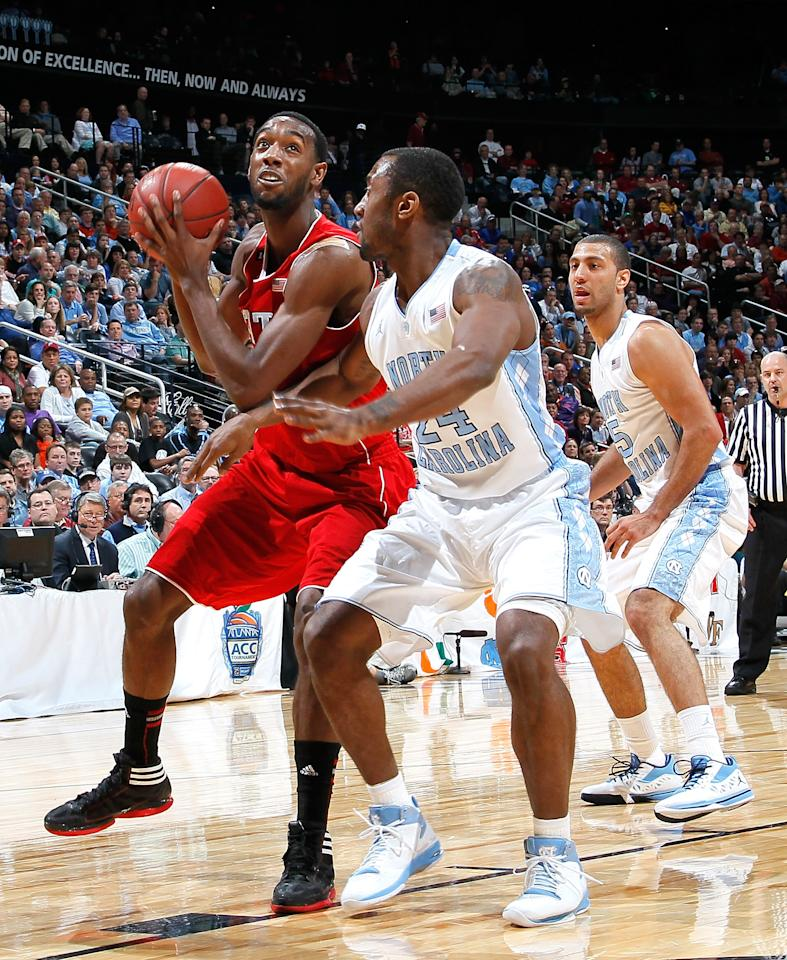 ATLANTA, GA - MARCH 10:  C.J. Leslie #5 of the North Carolina State Wolfpack drives against Justin Watts #24 of the North Carolina Tar Heels during the semifinals of the 2012 ACC Men's Basketball Conference Tournament at Philips Arena on March 10, 2012 in Atlanta, Georgia.  (Photo by Kevin C. Cox/Getty Images)