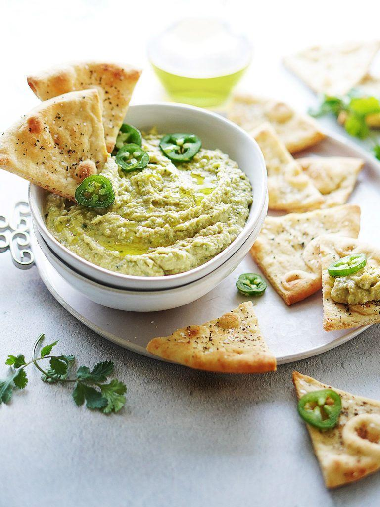 """<p>It's no secret hummus is the ideal dip—it contains loads of flavor, plus protein and fiber from the chickpeas, and healthy fats from the tahini. Add the festive tastes of cilantro, jalapeño, cumin, paprika and garlic into the mix, and you're basically snacking like a vegan pro.</p><p><a class=""""link rapid-noclick-resp"""" href=""""https://www.muydelish.com/cilantro-jalapeno-hummus/"""" rel=""""nofollow noopener"""" target=""""_blank"""" data-ylk=""""slk:GET THE RECIPE"""">GET THE RECIPE</a></p><p><em>Per serving: 322 calories, 13 g fat (2 g saturated), 382 mg sodium, 42 g carbs, 19 g sugar, 9 g fiber, 11 g protein</em></p>"""