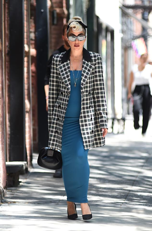 <p>For a super casj stroll in New York, Lady Gaga donned a not-so-casual outfit of a figure-hugging maxi dress with a plaid black-and-white coat. Extra points for the 50s hairdo and supersized sunglasses. <em>[Photo: Rex]</em> </p>