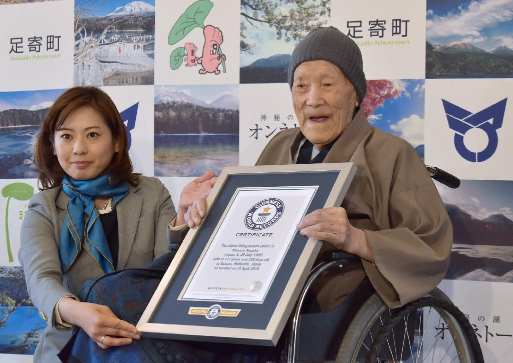 Masazo Nonaka enjoyed eating sweets and soaking in a hot spring. He was awarded the title ofoldest man in April (AFP Photo/JIJI PRESS)
