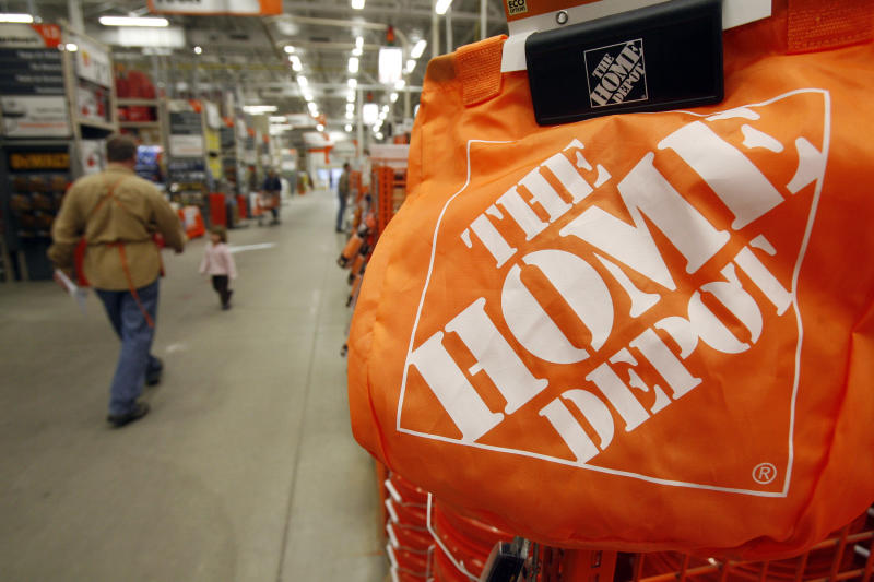 FILE -0 In this file photograph taken Feb. 23, 2010, shoppers and sales representatives walk through the aisles at the Home Depot store in Williston, Vt. Modest sales increases helped boost Home Depot Inc.'s second-quarter net income 7 percent Tuesday, Aug. 17, 2010. (AP Photo/Toby Talbot, file)