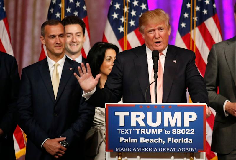 Trump speaks withcampaign manager Corey Lewandowski at his side in 2016.