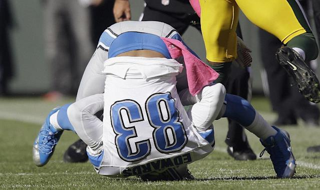 Detroit Lions' Pat Edwards lands on his head after catching a pass during the second half of an NFL football game against the Green Bay Packers Sunday, Oct. 6, 2013, in Green Bay, Wis. The Packers won 22-9. (AP Photo/Jeffrey Phelps)