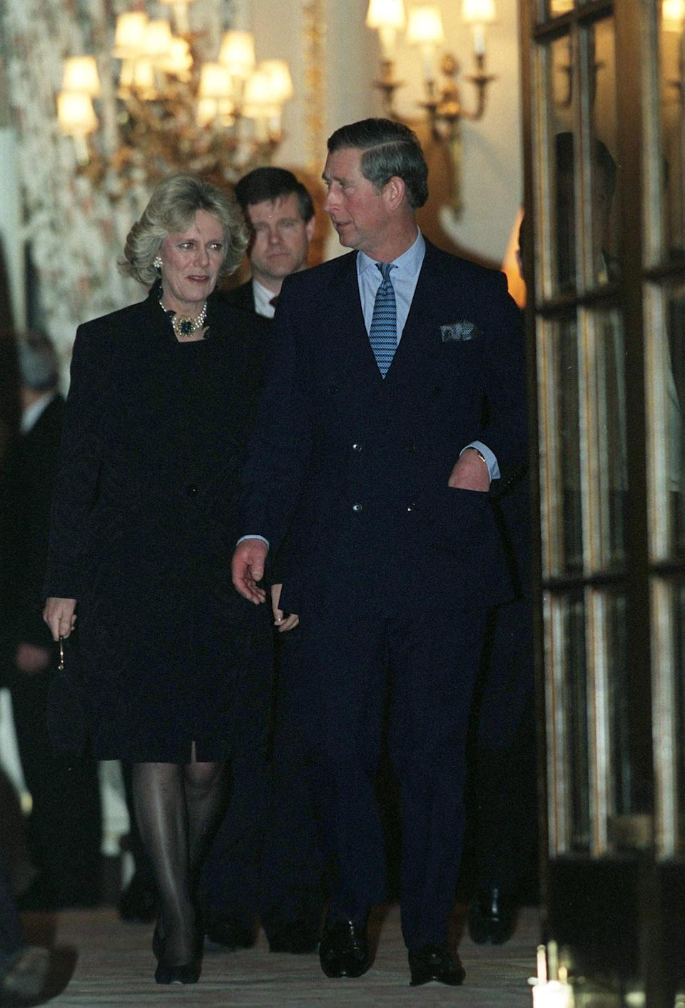 "<p>Soon after his divorce was finalized, Charles began slowly introducing Camilla into his life at large. Those plans were put on hold, however, after Diana's death in a car accident in 1997. By 1998, things were discreetly back on track, and a spokesperson for the prince confirmed a <strong>Guardian</strong> report that <a href=""http://www.theguardian.com/theguardian/1998/jul/10/fromthearchive"" class=""link rapid-noclick-resp"" rel=""nofollow noopener"" target=""_blank"" data-ylk=""slk:Camilla had been introduced to Prince William"">Camilla had been introduced to Prince William</a>.</p> <p>In January 1999, Charles and Camilla orchestrated their first public appearance together, leaving a 50th birthday party for Camilla's sister together. Later that year, the BBC reported, <a href=""http://news.bbc.co.uk/2/hi/uk_news/4410551.stm"" class=""link rapid-noclick-resp"" rel=""nofollow noopener"" target=""_blank"" data-ylk=""slk:Camilla joined Charles and his sons"">Camilla joined Charles and his sons</a> on a vacation in Greece.</p>"
