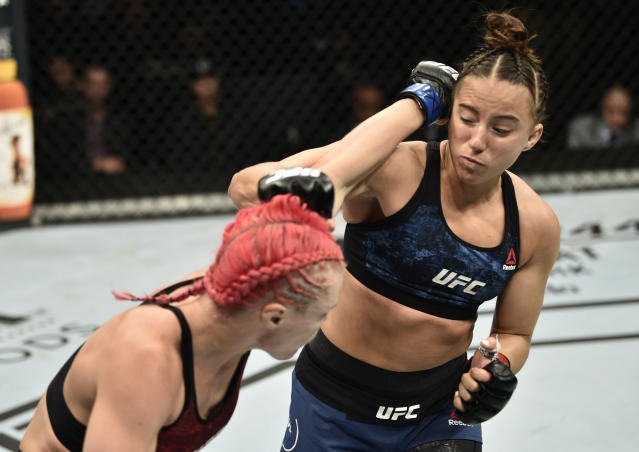 (R-L) Maycee Barber and Gillian Robertson trade punches in their flyweight bout during the UFC Fight Night event at TD Garden on Oct. 18, 2019 in Boston. (Chris Unger/Zuffa LLC via Getty Images)