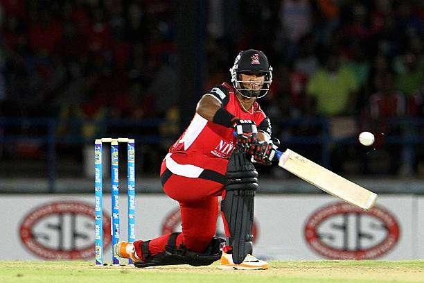 PORT OF SPAIN, TRINIDAD AND TOBAGO - AUGUST 09: Nicholas Pooran sweeps during the Eleventh Match of the Cricket Caribbean Premier League between Trinidad and Tobago Red Steel v Guyana Amazon Warriors at Queen's Park Oval on August 9, 2013 in Port of Spain, Trinidad and Tobago. (Photo by Ashley Allen/Getty Images Latin America for CPL)