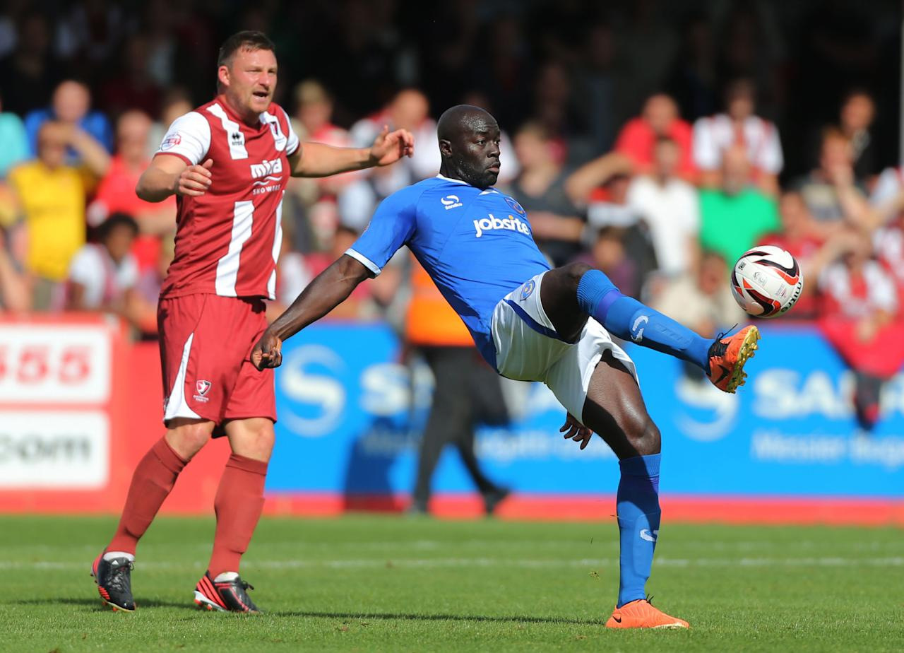 Portsmouth's Patrick Agyemang controls ball away from Cheltenham Town defender Steve Elliott during the Sky Bet Football League Two match at the Abbey Business Stadium, Cheltenham.