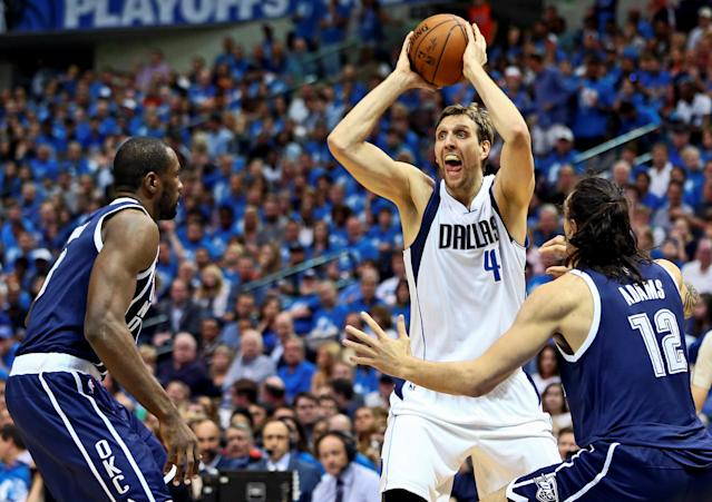 FILE PHOTO: Apr 23, 2016; Dallas, TX, USA; Dallas Mavericks forward Dirk Nowitzki (41) looks to pass as Oklahoma City Thunder center Steven Adams (12) defends during the second quarter in game four of the first round of the NBA Playoffs at American Airlines Center. Mandatory Credit: Kevin Jairaj-USA TODAY Sports / Reuters Picture Supplied by Action Images (TAGS: Sport Basketball NBA)/File Photo *** Local Caption *** 2016-04-24T014540Z_1857909049_NOCID_RTRMADP_3_NBA-PLAYOFFS-OKLAHOMA-CITY-THUNDER-AT-DALLAS-MAVERICKS.JPG - MT1ACI14360078