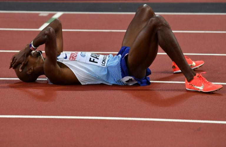 Britain's Mo Farah reacts after finishing second to take silver in the final of the men's 5000m athletics event at the 2017 IAAF World Championships at the London Stadium in London on August 12, 2017