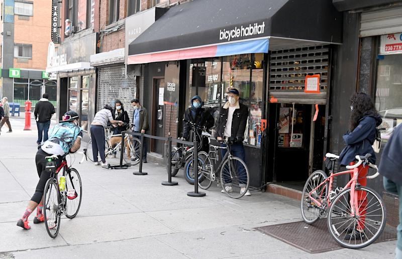 NEW YORK, NY - APRIL 25: Bicyclists wear face masks waiting in line in front of a bicycle shop during the coronavirus pandemic on April 25, 2020 in New York City. COVID-19 has spread to most countries around the world claiming over 202,000 lives lost with over 2.9 million infections reported. (Photo by Jamie McCarthy/Getty Images)