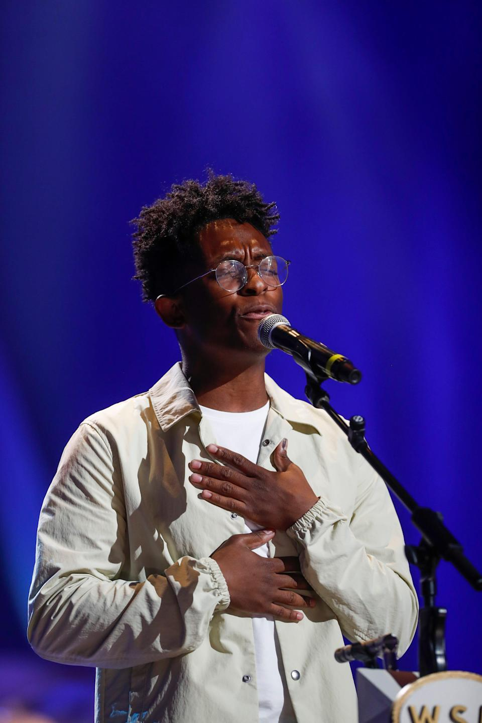 """Breland performs """"Cross Country"""" at Loretta Lynn's Friends Hometown Rising benefit concert for flood relief at the Grand Ole Opry in Nashville, Tenn., on Sept. 13."""