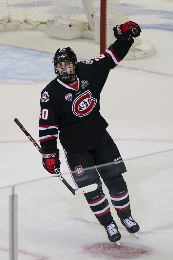 St. Cloud State's Nolan Walker celebrates after scoring a goal with less than a minute left to break a tie against Minnesota State during the third period of an NCAA men's Frozen Four hockey semifinal in Pittsburgh, Thursday, April 8, 2021. St. Cloud State won 5-4 to advance to the championship game Saturday. (AP Photo/Keith Srakocic)