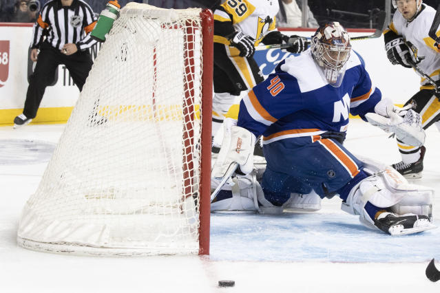 New York Islanders goaltender Semyon Varlamov makes a save against the Pittsburgh Penguins during the first period of an NHL hockey game Thursday, Nov. 7, 2019, in New York. (AP Photo/Mary Altaffer)