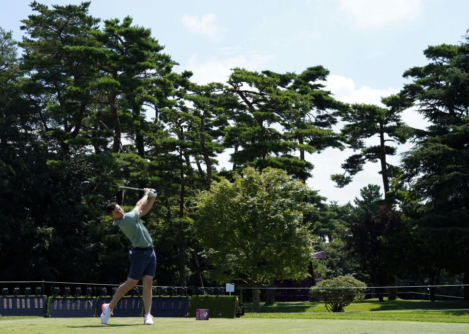 Ireland's Rory McIlroy watches his tee shot on the 12th hole during practice round of the men's golf event at the 2020 Summer Olympics, Tuesday, July 27, 2021, at the Kasumigaseki Country Club in Kawagoe, Japan, (AP Photo/Matt York)