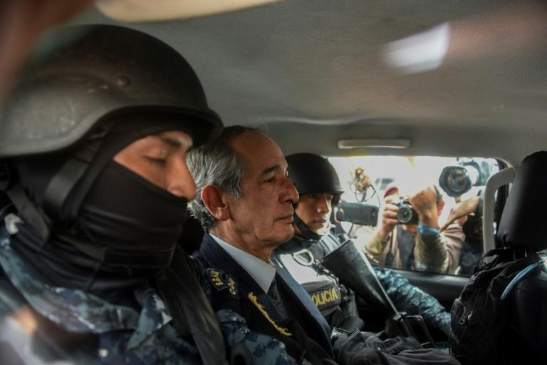 Former Guatemalan president Alvaro Colom (center) is arrested on corruption charges in Guatemala City on February 13, 2018
