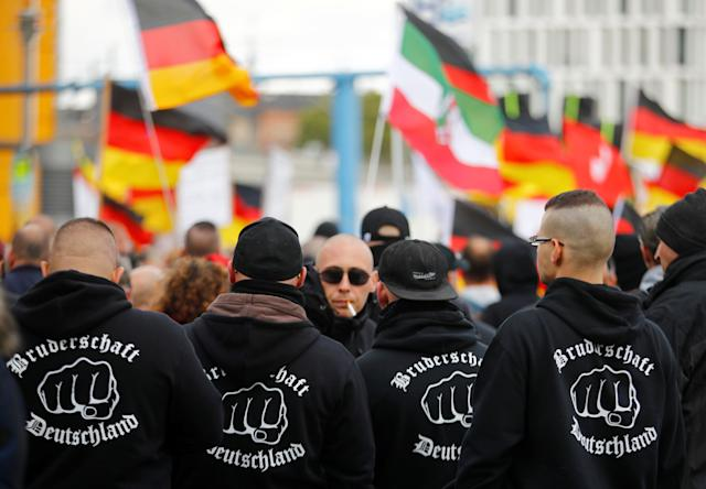 "People attend a far-right wing demonstration in Berlin, Germany, October 3, 2019. The hoodies read ""Brotherhood Germany."" Credit: Reuters/Hannibal Hanschke"