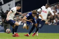 Chelsea's Marcos Alonso vies for the ball with Tottenham's Emerson Royal, right, and Pierre-Emile Hojbjerg, left, during the English Premier League soccer match between Tottenham Hotspur and Chelsea at the Tottenham Hotspur Stadium in London, England, Sunday, Sep. 19, 2021. (AP Photo/Matt Dunham)
