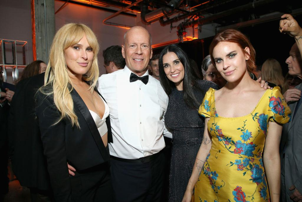 Bruce Willis and Demi Moore have remained on good terms, pictured here with their daughters in LA in July, 2018 (Getty Images)