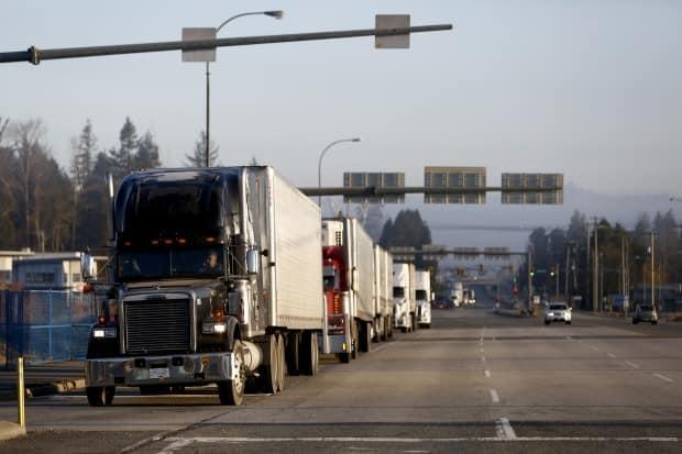 Truckers like Swift Current's Christopher Worsley must cross into the U.S. to do their job. (Jesse Winter/Reuters - image credit)