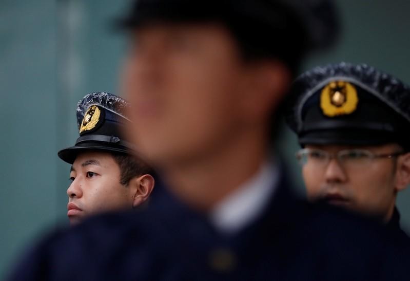 Security personnel keep watch near the Imperial Palace, on the day Emperor Naruhito is formally enthroned, in Tokyo