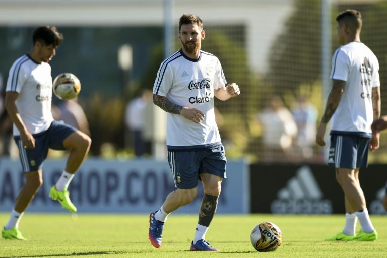 Argentina's Lionel Messi controls the ball during a training session in Ezeiza, Buenos Aires, on March 25, 2017, ahead of their Russia 2018 World Cup qualifier against Bolivia