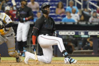Miami Marlins' Jesus Sanchez slams his bat to the ground after striking out during the ninth inning of the team's baseball game against the Pittsburgh Pirates, Saturday, Sept. 18, 2021, in Miami. The Pirates won 6-3. (AP Photo/Marta Lavandier)