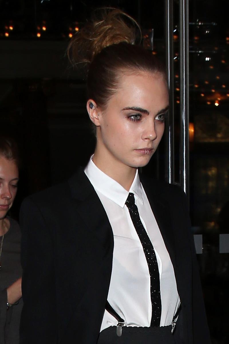 Cara Delevingne was spotted in a menswear-inspired look in London last year. (Photo: Getty Images)