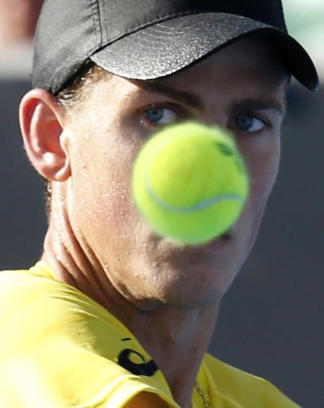 Vasek Pospisil of Canada watches the ball during his men's singles match against Samuel Groth of Australia at the Australian Open 2014 tennis tournament in Melbourne January 13, 2014. REUTERS/Bobby Yip (AUSTRALIA - Tags: SPORT TENNIS)