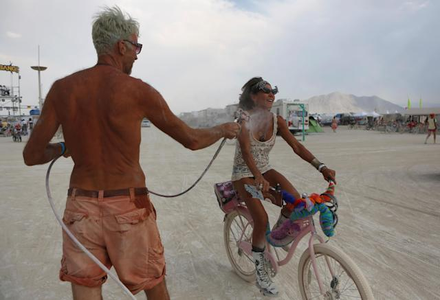 <p>Participants get misted by compressed air and water as approximately 70,000 people from all over the world gathered for the annual Burning Man arts and music festival in the Black Rock Desert of Nevada, Aug. 30, 2017. (Photo: Jim Urquhart/Reuters) </p>