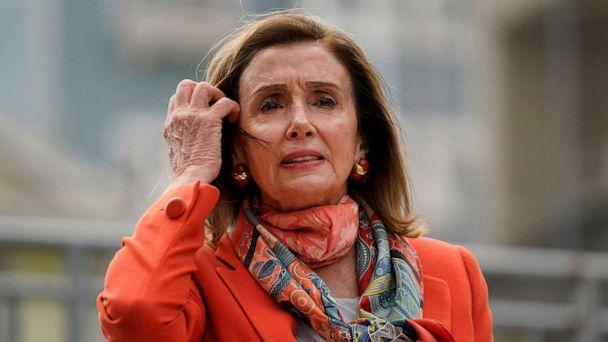 PHOTO: House Speaker Nancy Pelosi pulls back her hair while speaking about her visit to a hair salon during a news conference at the Mission Education Center Elementary School Wednesday, Sept. 2, 2020, in San Francisco. (Eric Risberg/AP)