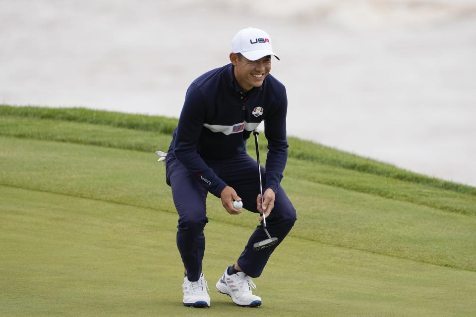 Team USA's Collin Morikawa smiles on the third hole during a practice day at the Ryder Cup at the Whistling Straits Golf Course Thursday, Sept. 23, 2021, in Sheboygan, Wis. (AP Photo/Jeff Roberson)
