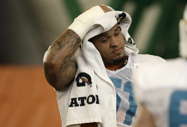 Miami Dolphins center Mike Pouncey wipes his head with a towel during NFL football practice, Monday, Nov. 4, 2013, in Davie, Fla. The Dolphins suspended guard Richie Incognito Sunday for misconduct related to the treatment of teammate Jonathan Martin, who abruptly left the team a week ago to receive help for emotional issues. Neither Incognito nor Martin were at practice Monday. (AP Photo/Lynne Sladky)