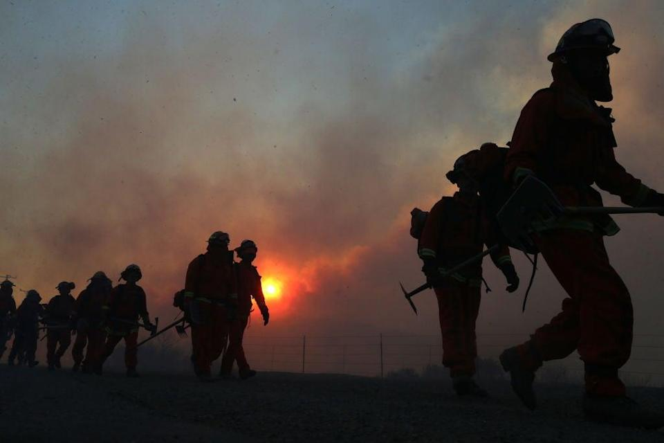 The Biden administration raised the pay for federal firefighters to a minimum of $15 an hour on 30 June ahead of a potentially severe wildfire season (Getty Images)