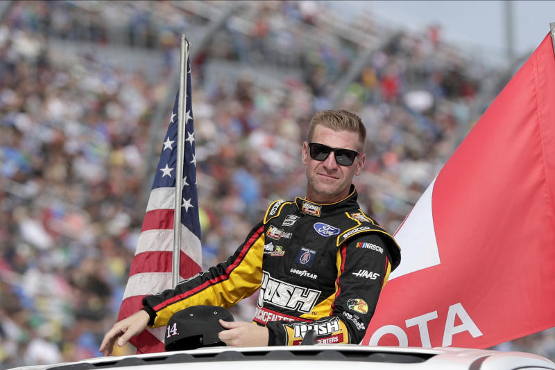 Clint Bowyer takes a parade lap in front of fans before the NASCAR Daytona 500 auto race at Daytona International Speedway, Sunday, Feb. 16, 2020, in Daytona Beach, Fla. (AP Photo/John Raoux)